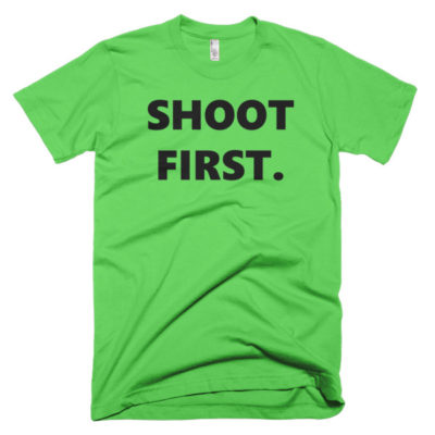 green tshirt that says shoot first