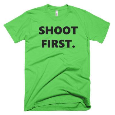 green tshirt that says shoot first