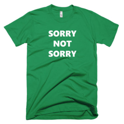 green tshirt that says sorry not sorry
